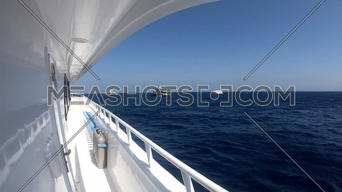 Long shot for Red Sea from yacht showing scuba tools and yachts at day.
