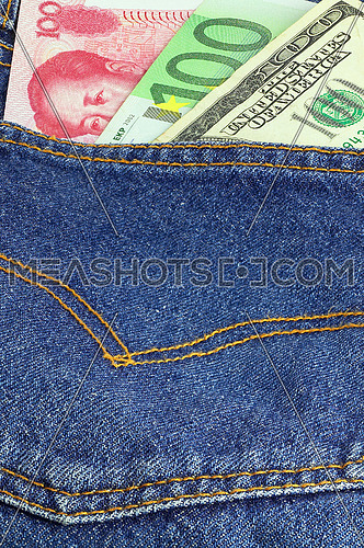 money bills on pocket of a pair of blue jeans