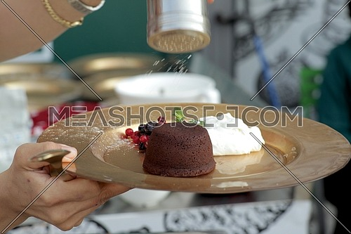female hands holding a Chocolate fondue plate