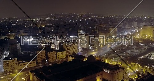 360 Drone shot for 6 of October Bridge over Abd Elmonan Reyad Bus Station towards Tahrir Square and revealing The Nile Ritz Carlton Hotel in cairo at night