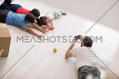 Photoshooting with kids models at studio as new modern home