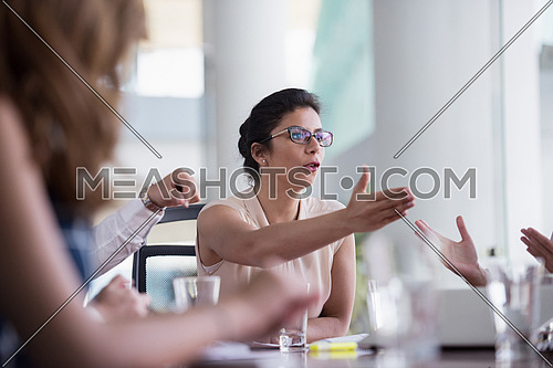 portrait of middle eastern business woman as leader  on meeting at modern office interior