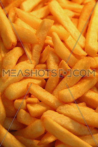 French fries, unhealthy deep fried potato chips close up, high angle view