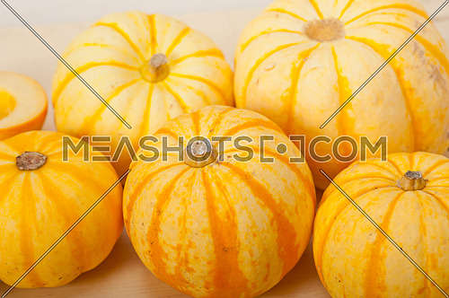 bunch of fresh yellow pumpkins just collected from garden