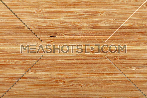 Used wooden bamboo chopping cutting board background texture with cuts, scratches and hacks