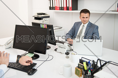 Happy Young Business Men Work In Modern Office On Computer
