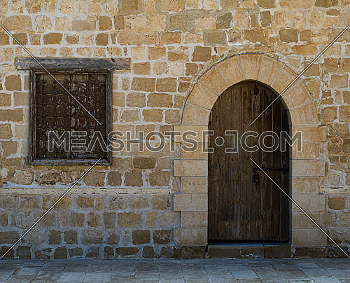 Door and window of one of the rooms surrounding the main courtyard of Qaitbay Castle, a fort of Alexandria, Egypt