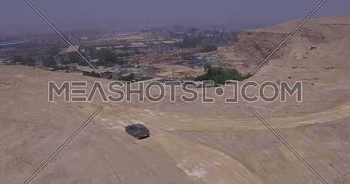 Reveal Shot for the Industrial Area from over Al Mukattam Mountain in cairo at Day