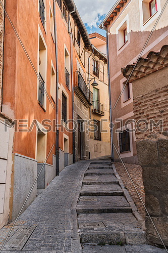 Old street of the quarter of the Jewry houses front constructed with seen brick located in the city of Segovia, Unesco World Heritage Site, Spain
