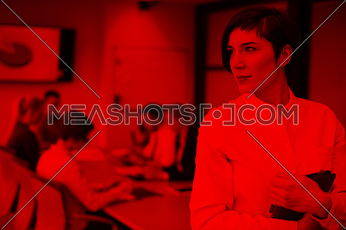 young hispanic businesswoman portrait with  tablet computer at modern startup business office interior, people group on team meeting blured in background
