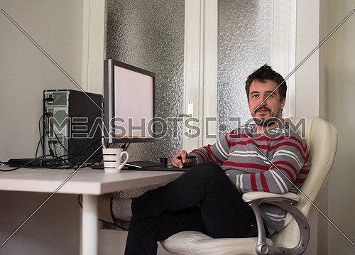 graphic designer working on a digital tablet and a computer