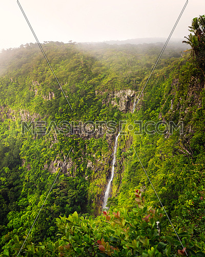 Amazing panorama of waterfall Black River Gorges and jungle around it, Mauritius.Vertical photo.