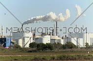 industrial factory chimney polluting  the air