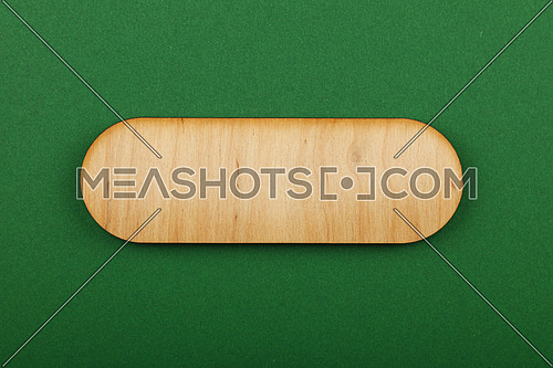 Figured ornately shaped blank wooden sign with round corners and copy space in center of green design paper background, title slide template