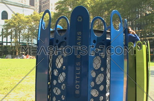 Pan right For a recycling blue basket in a park at New York City at day