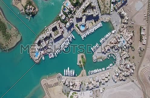 Zoom in using Drone shot flying above Al Gouna at Day