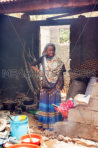 An african Girl In Kitchen
