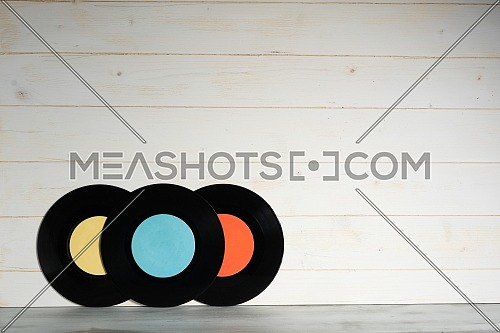 Three Vinyl records on wooden background,Old vintage vinyl records isolated