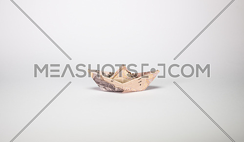 one Egyptian Pound folded like paper boat floating concept