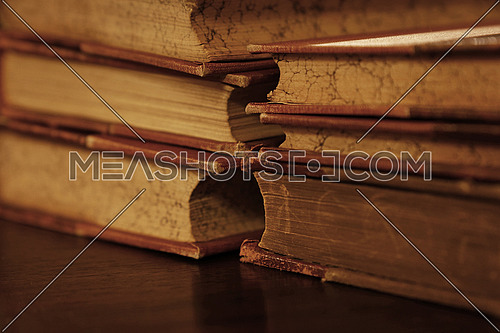 Stack of six old vintage brown leather hardcover books on table