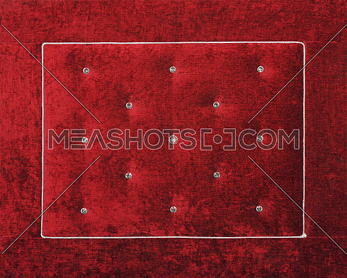 Close up background of dark red burgundy color soft velvet bed headboard with rhinestone crystals, front view