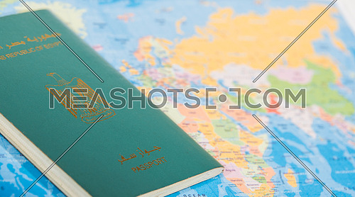 Close up shot for Egyptian Passport put on a map.