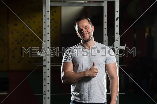 Smiling Successful Young Man Showing Thumb Up