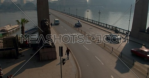 Reveal shot Drone for Kasr Al Nile Bridge from the Lions Statues in Cairo Downtown at early morning