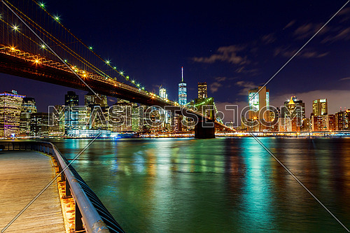 Brooklyn Bridge over East River at night in New York City