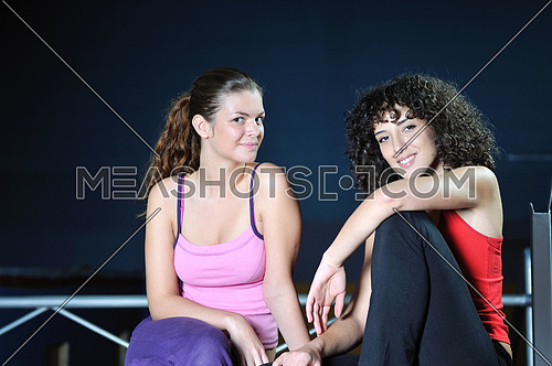 two women work out and streaching  in fitness club