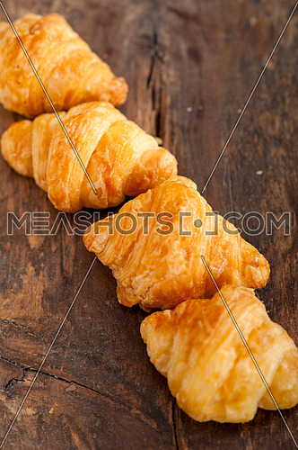fresh croissant french brioche over old wood table