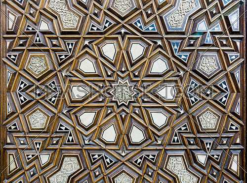 Closeup of arabesque ornaments of an old an aged decorated wooden door, Al Rifaii Mosque, Old Cairo, Egypt
