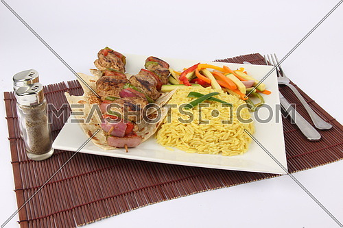 a photo for a grilled meat dish with rice and steamed vegetables