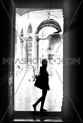 A girl standing at the door Mohamed Ali Mosque Cairo, egypt