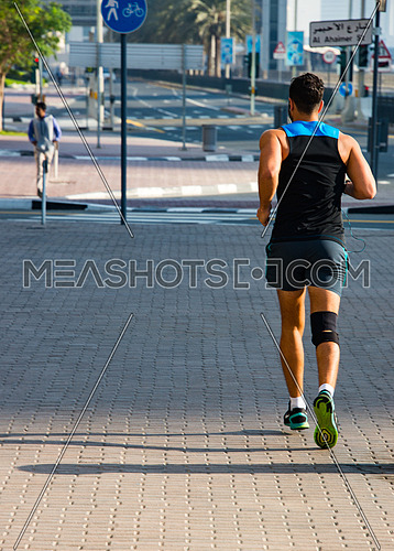 a man joging early in the morning in the streets