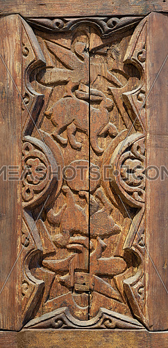 Fatimid era style engraved wooden panel decorated with animal based decorations inside geometric and floral patterns, Cairo, Egypt