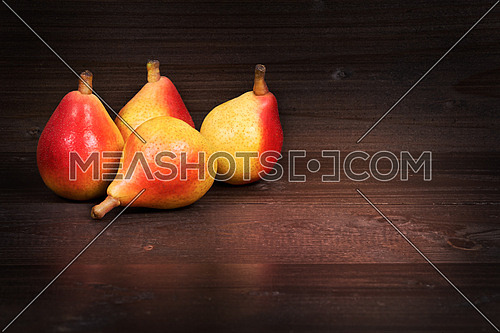 In the picture four pears \