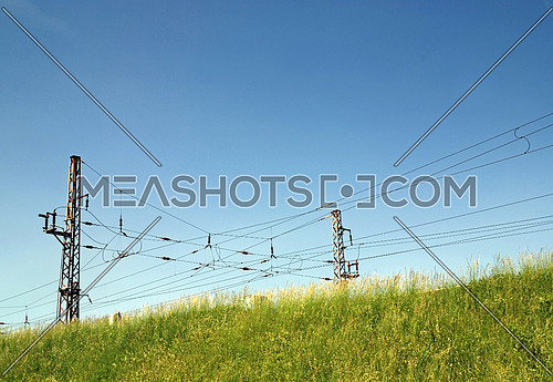 Electric power Lines over nature landscape