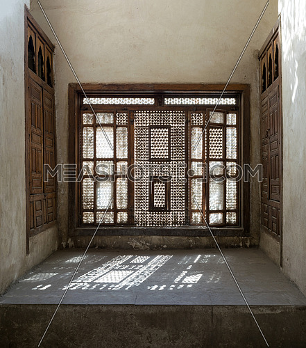 Interleaved wooden window (Mashrabiya) with built-in couch, Zeinab Khatoun House, Medieval Cairo, Egypt