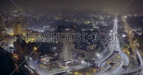 Aerial Shot flying towards the Hilton Hotel showing the River Nile, Bridge and Television Network Building in cairo at night