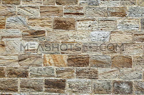Old stone masonry wall texture background, banner with irregular pattern