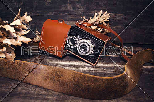 Vintage photo camera on a wooden surface