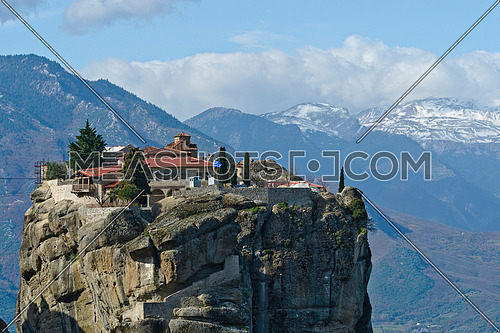 Panoramic view of the Orthodox Varlaam Monastery in Meteora, Greece on high mountain rock and blue sky