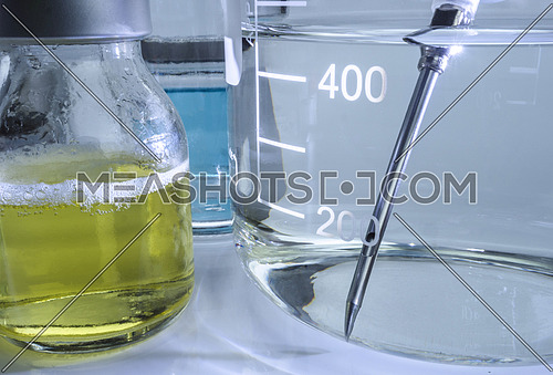 Laboratory instruments, medicine vial with flask, conceptual image, horizontal composition