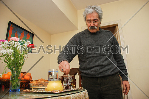 The late Egyptian novelist Ibrahim Aslan on October 22, 2010 during the preparation of a cup of tea.
