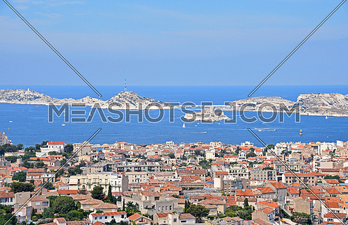 View of Marseille city, marina and port with the Chateau d'If, famous historical castle prison on island in Marseille bay, high angle view