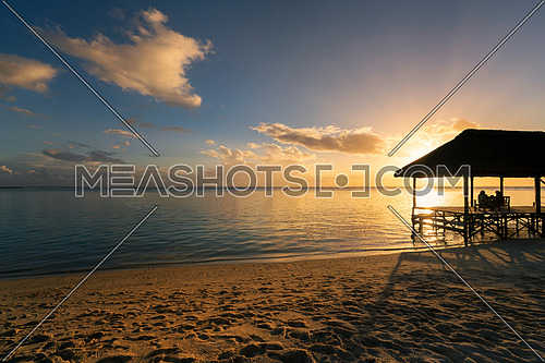 Relaxing on remote Paradise beach at sunset ,