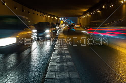 Track Left Shot for traffic from inside  Al Thawra Tunnel at Night