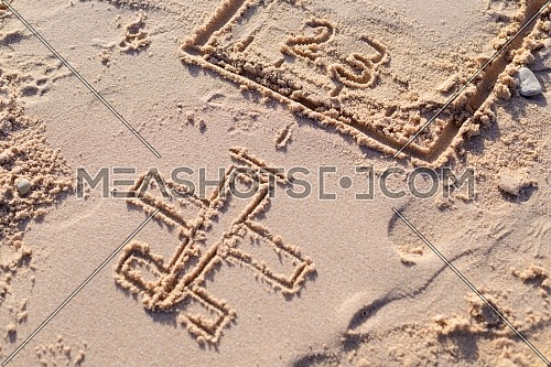 Close up shot for drawn plane on the sand - Egypt