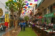timelaps in a shopping district in antalya, turkey showing a street covered in umbrellas